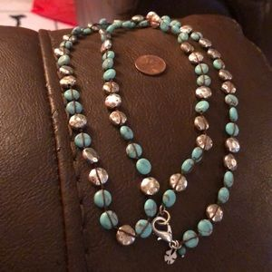 Turquoise and silver beads thread strung